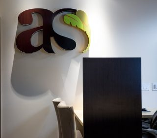 Dental Office Logo and Reception Area at Alluring Smiles in Mesa, AZ - Dr. Javier Portocarrero