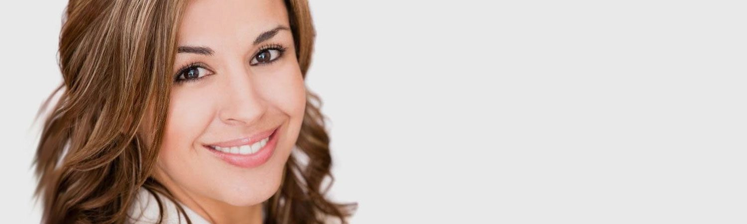 Woman with a Sweet Smile | Cosmetic Dentistry | Alluring Smiles in Mesa, AZ - Dr. Javier Portocarrero