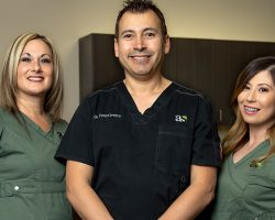 Dr. Portocarrero and his dental team at Alluring Smiles in Mesa, AZ - Dr. Javier Portocarrero