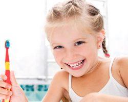 Giggling Young Girl | Pediatric Dentistry | Alluring Smiles in Mesa, AZ - Dr. Javier Portocarrero