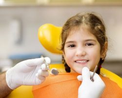 Young Kid Smiling Before Her Dental Examination | Preventative Orthodontics for Kids | Alluring Smiles in Mesa, AZ - Dr. Javier Portocarrero