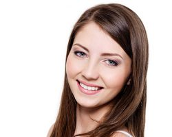 Serene-Looking Woman Smiling | Smile Makeover | Alluring Smiles in Mesa, AZ - Dr. Javier Portocarrero