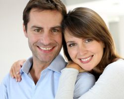 Smiling Young Husband and Wife | Tooth-Colored Fillings | Alluring Smiles in Mesa, AZ - Dr. Javier Portocarrero