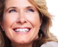 Content Smile of an Elderly Woman | Dental Veneers | Alluring Smiles in Mesa, AZ - Dr. Javier Portocarrero